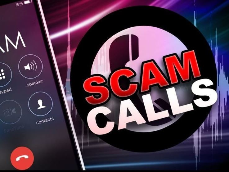 "Cell Phone next to ""Scam Calls"" warning message"