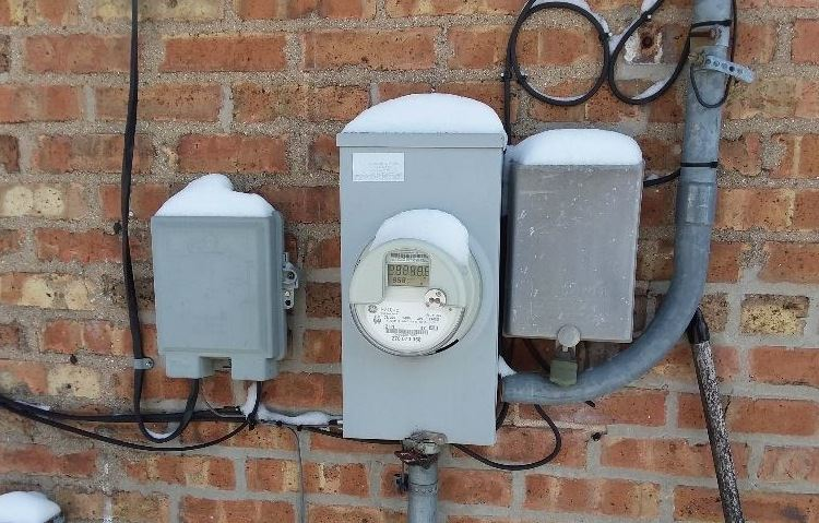 Smart Meter located on the brick wall of a home