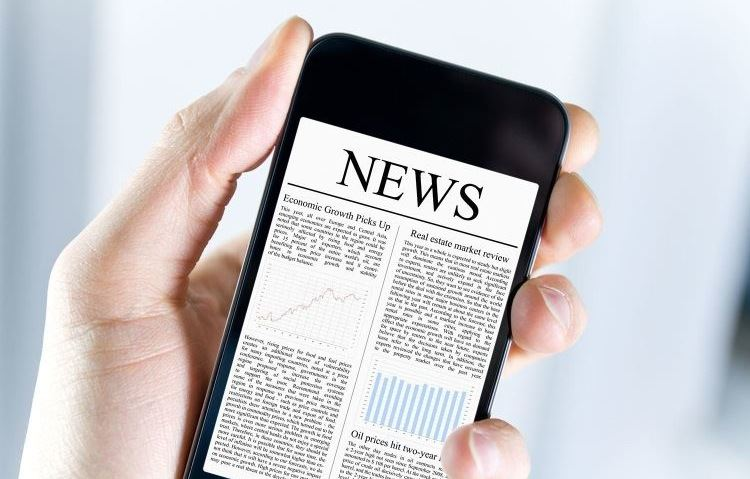 Handheld cellphone displaying news