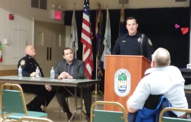 Police Chief Loni and Mayor Guerin listen to Officer Conway at a public meeting