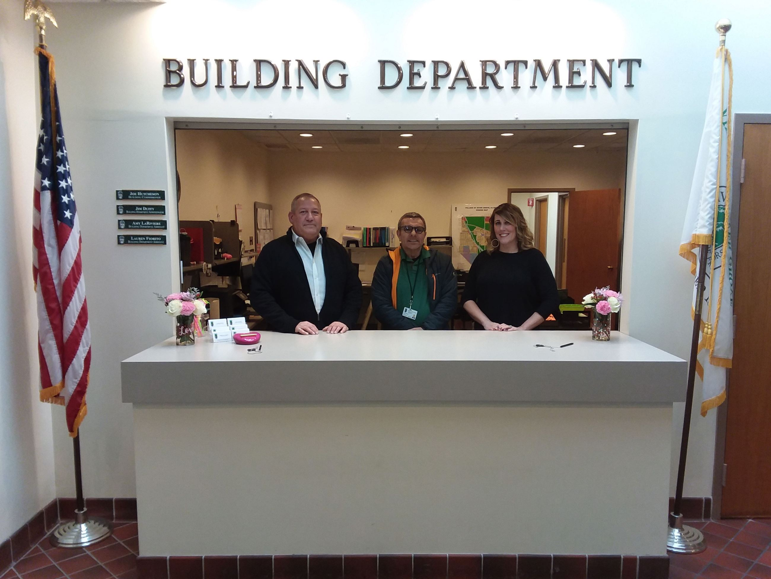Building Department staff members Jim Duffy, Joe Hutcheson and Amy LaRiviere