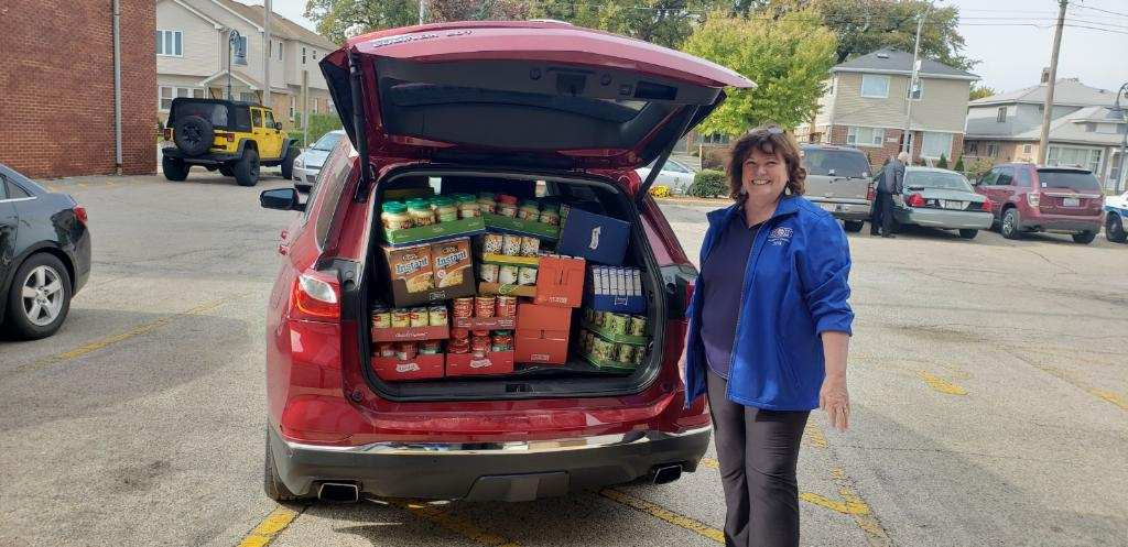Peggy Kasillis delivering supplies to the River Grove Food Pantry