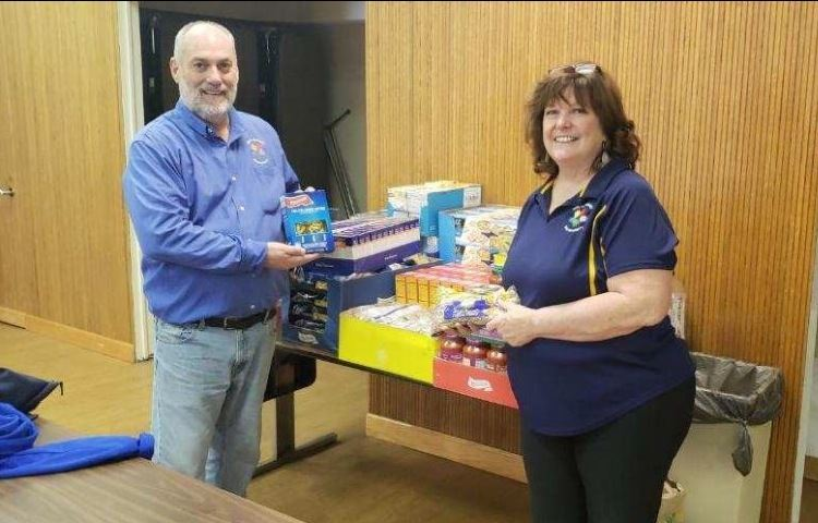 Tom Brimie and Peggy Kasillis delivering supplies to the River Grove Food Pantry