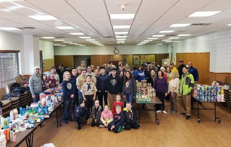 Holiday Food Drive volunteers stand together at the River Grove Food Pantry