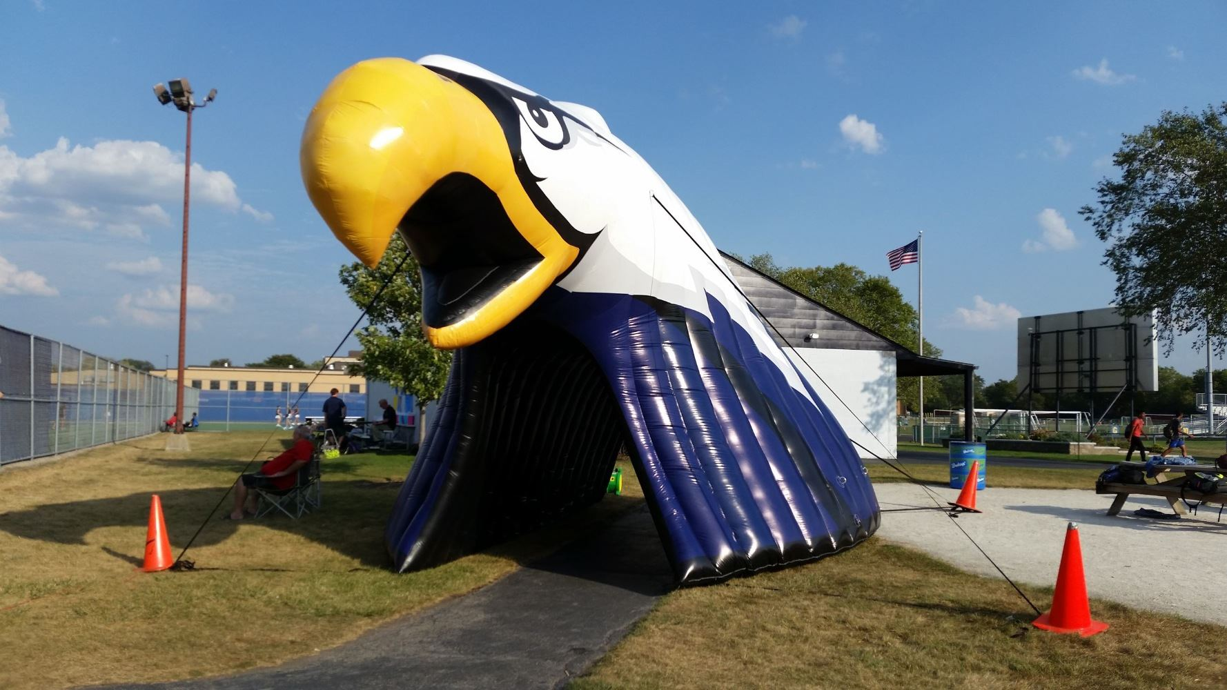 Large inflatable blue, white and gold head of an eagle