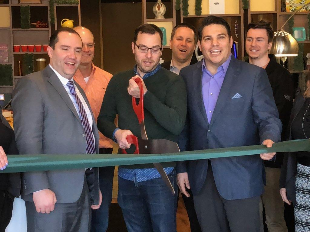Mayor Guerin, Brian Wilson and Ricardo Braglia cut the ribbon to officially open Stella's Place.