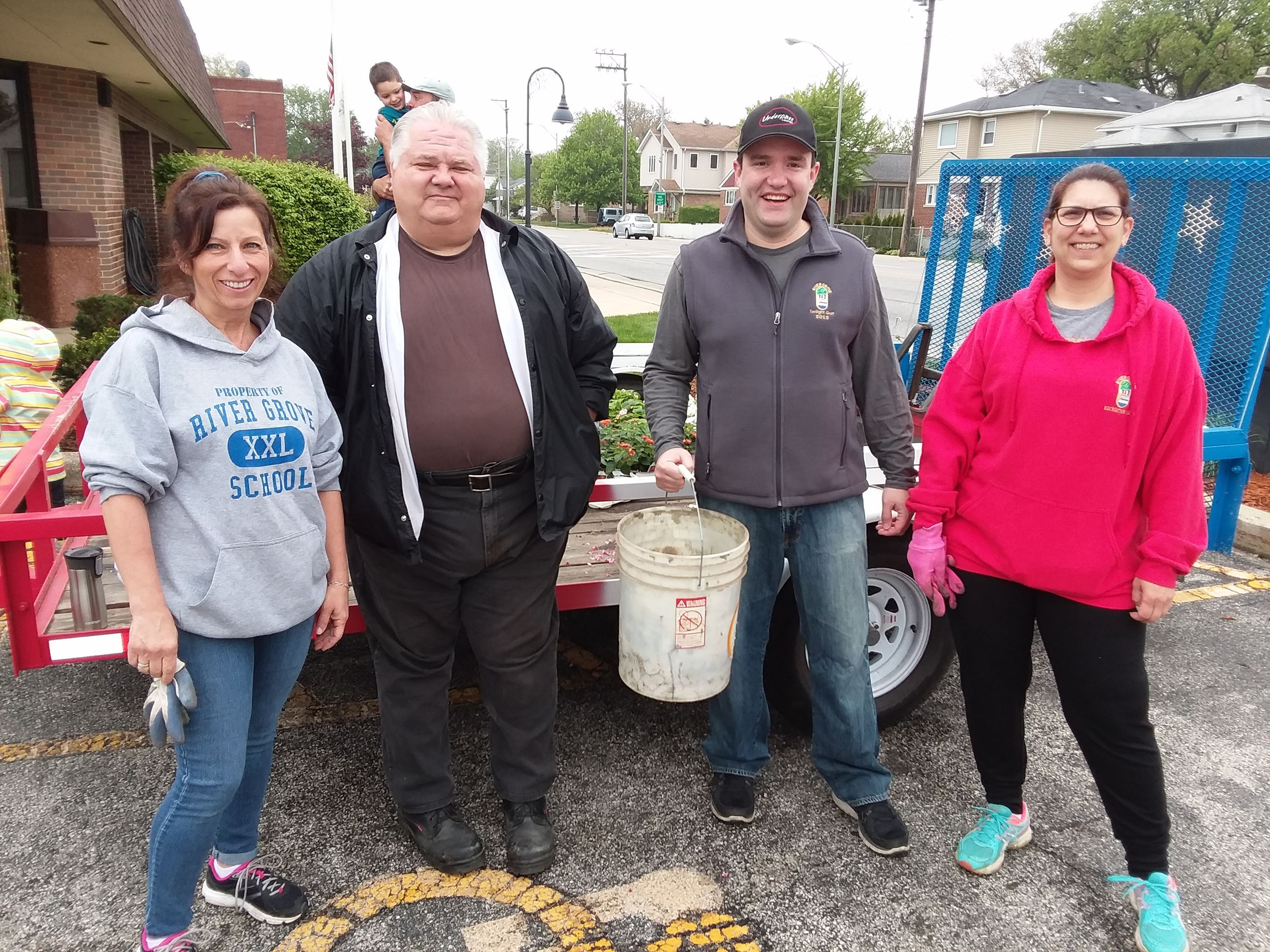 Mayor Guerin and Planting Day volunteers standing together outside Village Hall